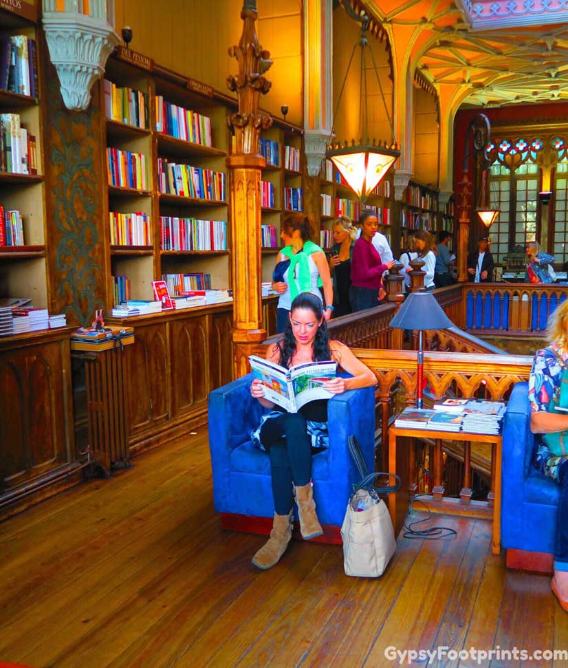 Me reading at the Lello Library in Porto